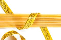 Spaghetti and measuring tape Royalty Free Stock Image