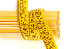 Spaghetti and measuring tape Stock Photography