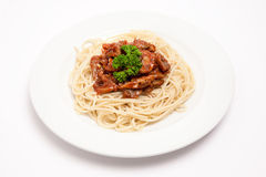 Spaghetti with meat. In white plate royalty free stock photo