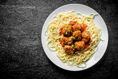 Spaghetti with meat balls on a plate royalty free stock photos