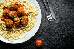 Spaghetti with meat balls on a plate stock photography