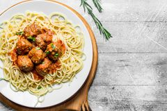 Spaghetti and meat balls on a plate stock images
