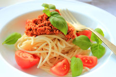 Spaghetti with meat in bolognese sauce with fresh basil and tomatos Stock Photography