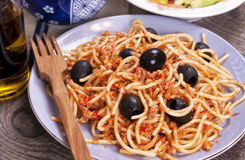 Spaghetti with meat bolognese sauce and olives Stock Images
