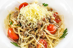 Spaghetti with meat and cherry. Tomato stock photo