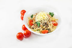 Spaghetti with meat. And cherry tomato royalty free stock image