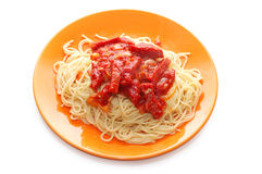 Spaghetti and meat with ketchup on orange plate Royalty Free Stock Photo