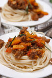 Spaghetti with meat and pumpkins Stock Images