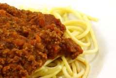 Spaghetti and Meat Sauce. Fresh cooked white spaghetti pasta and juicy tomato meat sauce, often referred to as Italian Spaghetti, on white porcelain plate and Stock Image