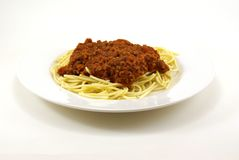 Spaghetti and Meat Sauce. Fresh cooked white spaghetti pasta and juicy tomato meat sauce, often referred to as Italian Spaghetti, on white porcelain plate and Royalty Free Stock Photo