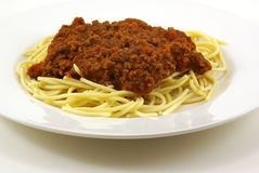 Spaghetti and Meat Sauce. Fresh cooked white spaghetti pasta and juicy tomato meat sauce, often referred to as Italian Spaghetti, on white porcelain plate and Royalty Free Stock Photography