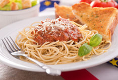 Spaghetti with Meat Sauce. Homemade spaghetti with meat sauce, garlic bread, and caesar salad royalty free stock image