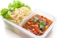 Spaghetti meat sauce ready to eat in lunch box, on white background isolated Royalty Free Stock Photos