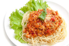 Spaghetti meat sauce ready to serve on white plate, on white background isolated Royalty Free Stock Images