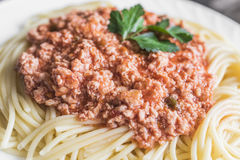 Spaghetti with meat sauce on white plate close up royalty free stock photo