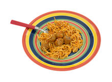 Spaghetti and meatball dinner on dish with fork Royalty Free Stock Image