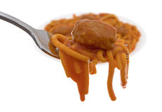 Spaghetti and a meatball on a fork with plate Stock Images