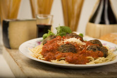 Spaghetti and meatballs. Plate of spaghetti and meatballs with Parmesan cheese, Chianti wine and basil Royalty Free Stock Photo