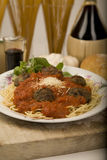 Spaghetti and meatballs. Plate of spaghetti and meatballs with Parmesan cheese, Chianti wine and basil Royalty Free Stock Photography