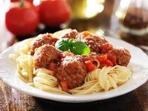 Spaghetti and meatballs with basil garnish. Photo of a plate of spaghetti and meatballs with basil garnish royalty free stock images