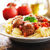 Spaghetti and meatballs with basil garnish Royalty Free Stock Image
