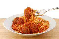 Spaghetti meatballs. Spaghetti and meatballs in a bowl with a fork stock photography