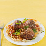 Spaghetti and meatballs with copyspace. Closeup photo of spaghetti and meatballs with copyspace in the composition. Selective focus on meatballs Stock Photos