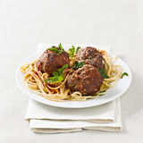 Spaghetti and meatballs with copyspace composition. Photo of spaghetti and meatballs with copyspace in the composition. Selective focus on meatballs Royalty Free Stock Image