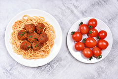 Spaghetti with meatballs and fresh tomatoes Royalty Free Stock Photos