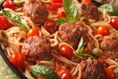 Spaghetti with meatballs, olives and tomato sauce macro. horizon Royalty Free Stock Image