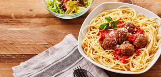 Spaghetti and Meatballs Served with Side Salad stock photography