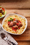 Spaghetti and Meatballs Served with Side Salad stock image