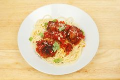 Spaghetti and meatballs. In a bowl on a wooden tabletop Stock Photo