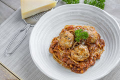 Spaghetti with Meatballs and tomato sauce and Parmesan cheese Royalty Free Stock Images