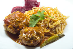 Spaghetti with meatballs on a white plate Stock Image