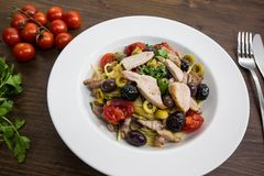 Spaghetti with Mediterranean tuna, capers, olives, Sicilian chil. Spaghetti with sauce consisting of: Mediterranean tuna, capers, olives, Sicilian chilli pepper Royalty Free Stock Photos