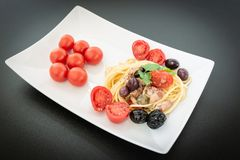 Spaghetti with Mediterranean tuna, capers, olives, Sicilian chil Stock Images