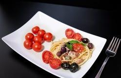 Spaghetti with Mediterranean tuna, capers, olives, Sicilian chil. Spaghetti with sauce consisting of: Mediterranean tuna, capers, olives, Sicilian chilli pepper Stock Photos