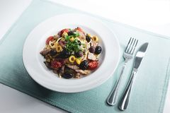Spaghetti with Mediterranean tuna, capers, olives, Sicilian chil. Spaghetti with sauce consisting of: Mediterranean tuna, capers, olives, Sicilian chilli pepper Stock Photography
