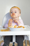 Spaghetti Mess. Little Girl Eating her dinner and making a mess Stock Photo