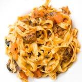 Spaghetti met aubergine stock afbeeldingen