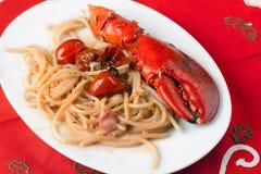 Spaghetti met Zeekreeft en Room Stock Foto's