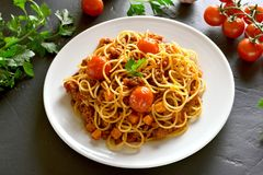 Spaghetti with minced meat and cherry tomatoes Royalty Free Stock Image