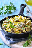 Spaghetti with mushroom and green onion in cream. royalty free stock photography