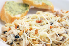 Spaghetti with mushroom sauce and cedar nuts Stock Images
