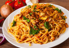 Spaghetti with mushroom, vegetables and minced meat Stock Photos