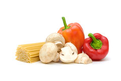 Spaghetti, mushrooms and peppers on a white background Stock Image