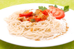 Spaghetti with mushrooms and tomatoes Stock Image