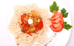 Spaghetti with mushrooms and tomatoes Stock Images