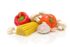 Spaghetti, mushrooms and vegetables on a white background Stock Image